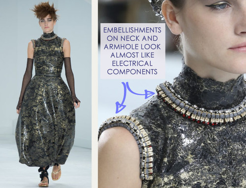 Encrusted Fabrics and Sculpted Silhouettes at Chanel | The Cutting Class. Chanel, Haute Couture, AW14, Paris, Image 17. Embellishments on neck and armhole look like electrical components.