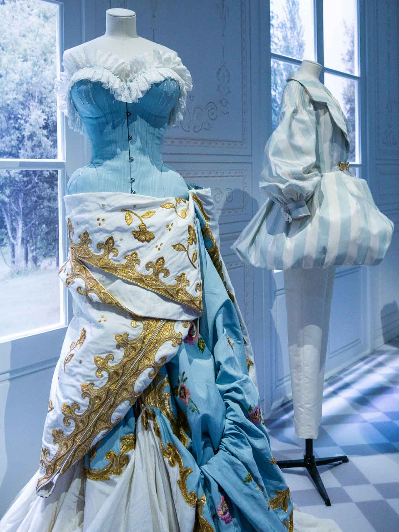 Blue, white and gold dress with historical and modern references. Christian Dior by John Galliano, Haute Couture, Autumn-Winter 2004. Taken at the V&A exhibition © The Cutting Class, 2019.