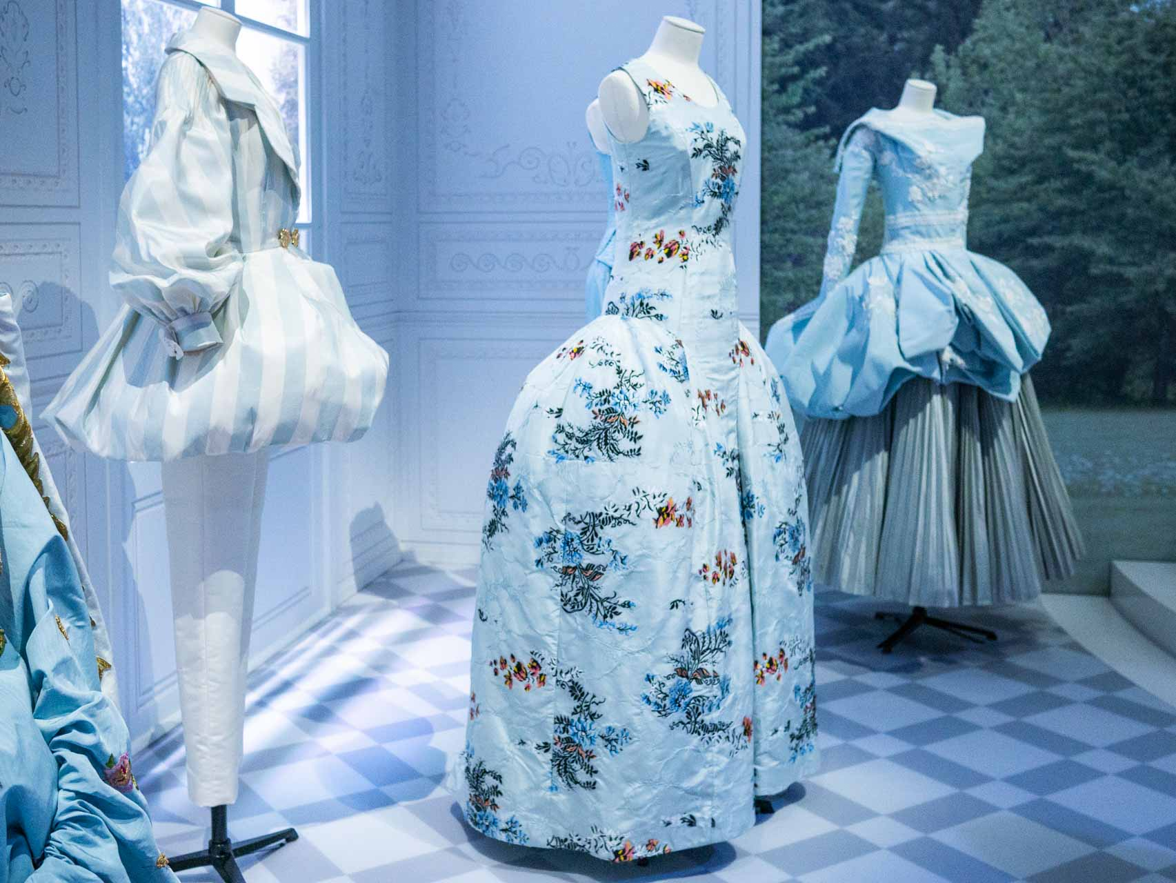 Pale blue dress with floral sprays with 18th-century inspired silhouette. Christian Dior by Raf Simons, Haute Couture, AW14. Taken at the V&A exhibition © The Cutting Class, 2019.