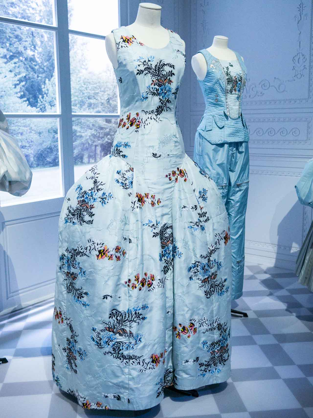 Pale blue dress with floral sprays with 18th-century inspired silhouette. Christian Dior by Raf Simons, Haute Couture, AW14. Taken at the V&A exhibition © The Cutting Class, 2019. Image 2.