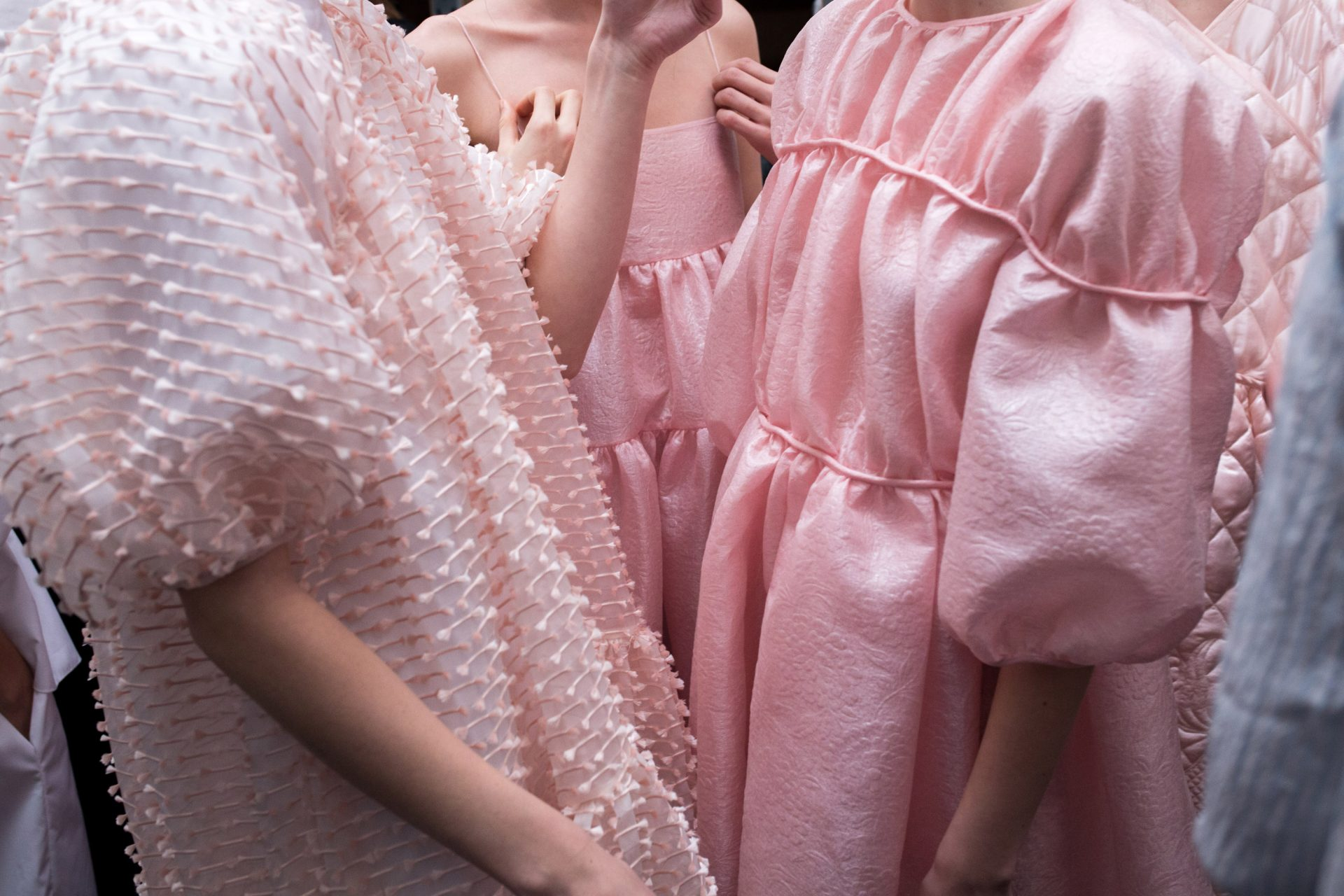 Textured fabric on pink dresses backstage at Cecilie Bahnsen Autumn-Winter 2018. The Cutting Class.
