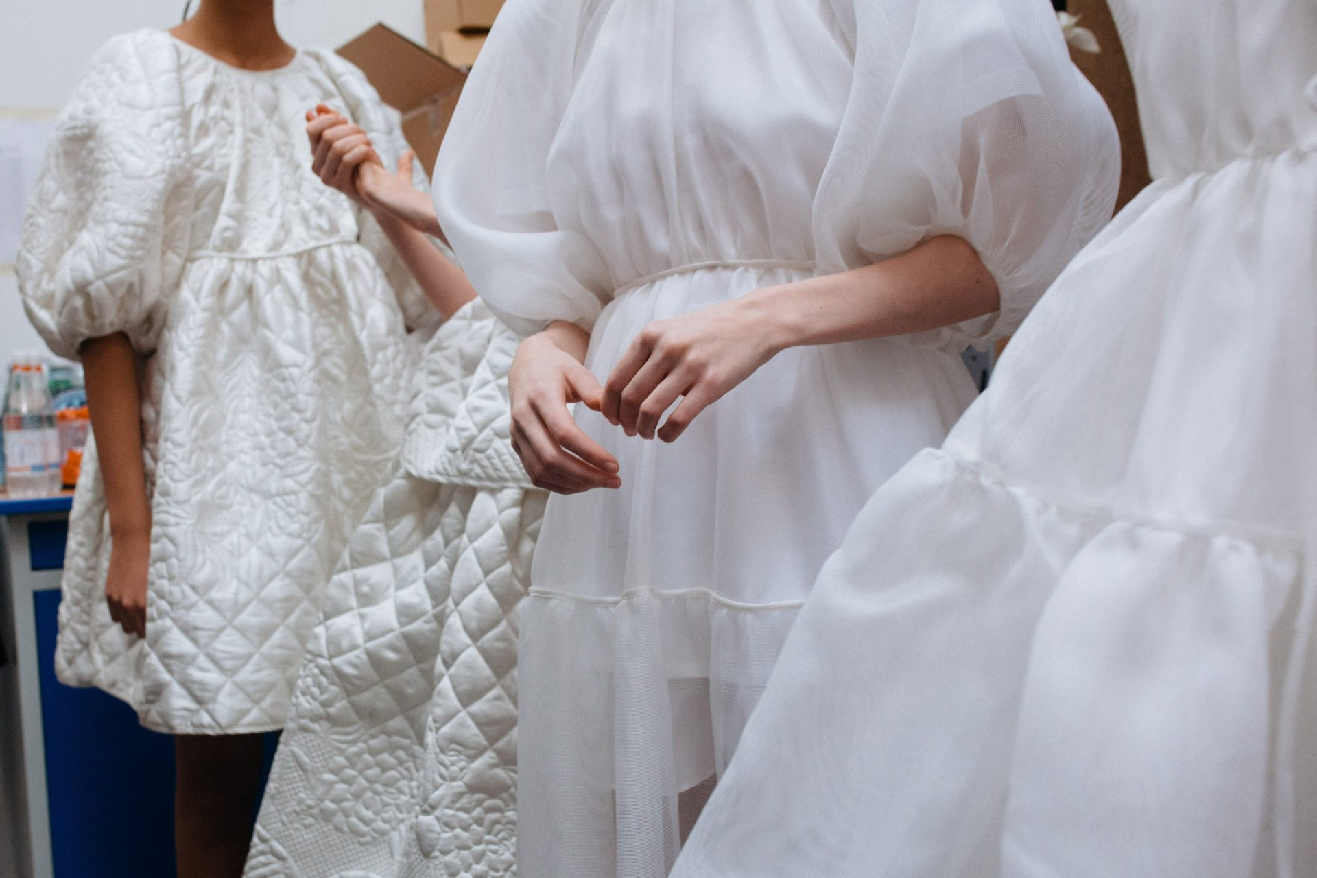 White dresses backstage at Cecilie Bahnsen AW18. The Cutting Class.