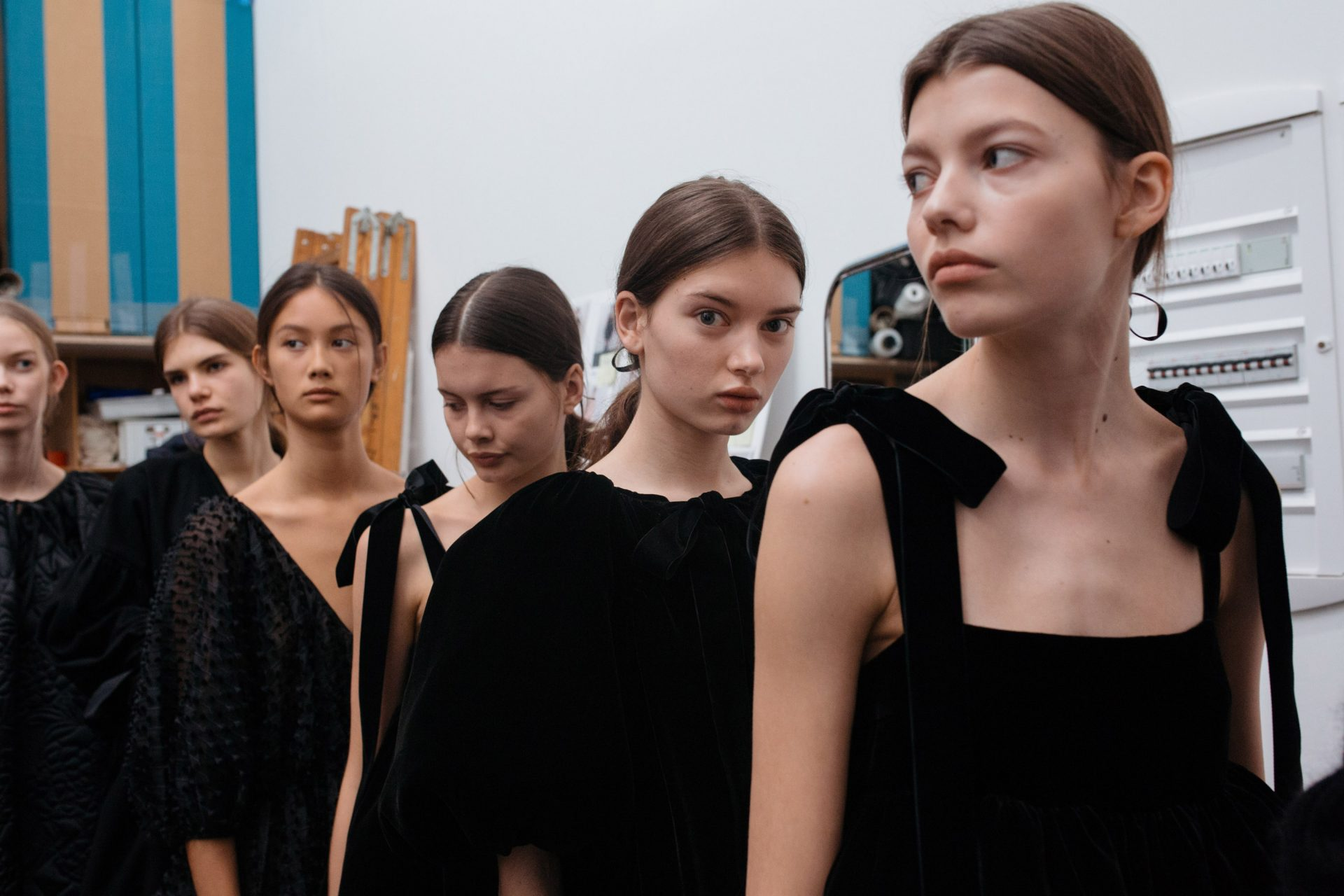 Models in black dresses backstage at Cecilie Bahnsen AW18. The Cutting Class.