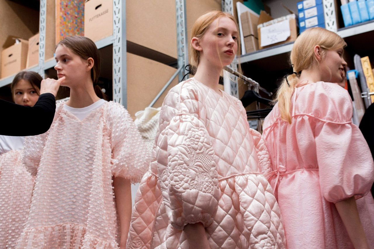 Models wearing Cecilie Bahnsen pink dresses from the AW18 collection. The Cutting Class.