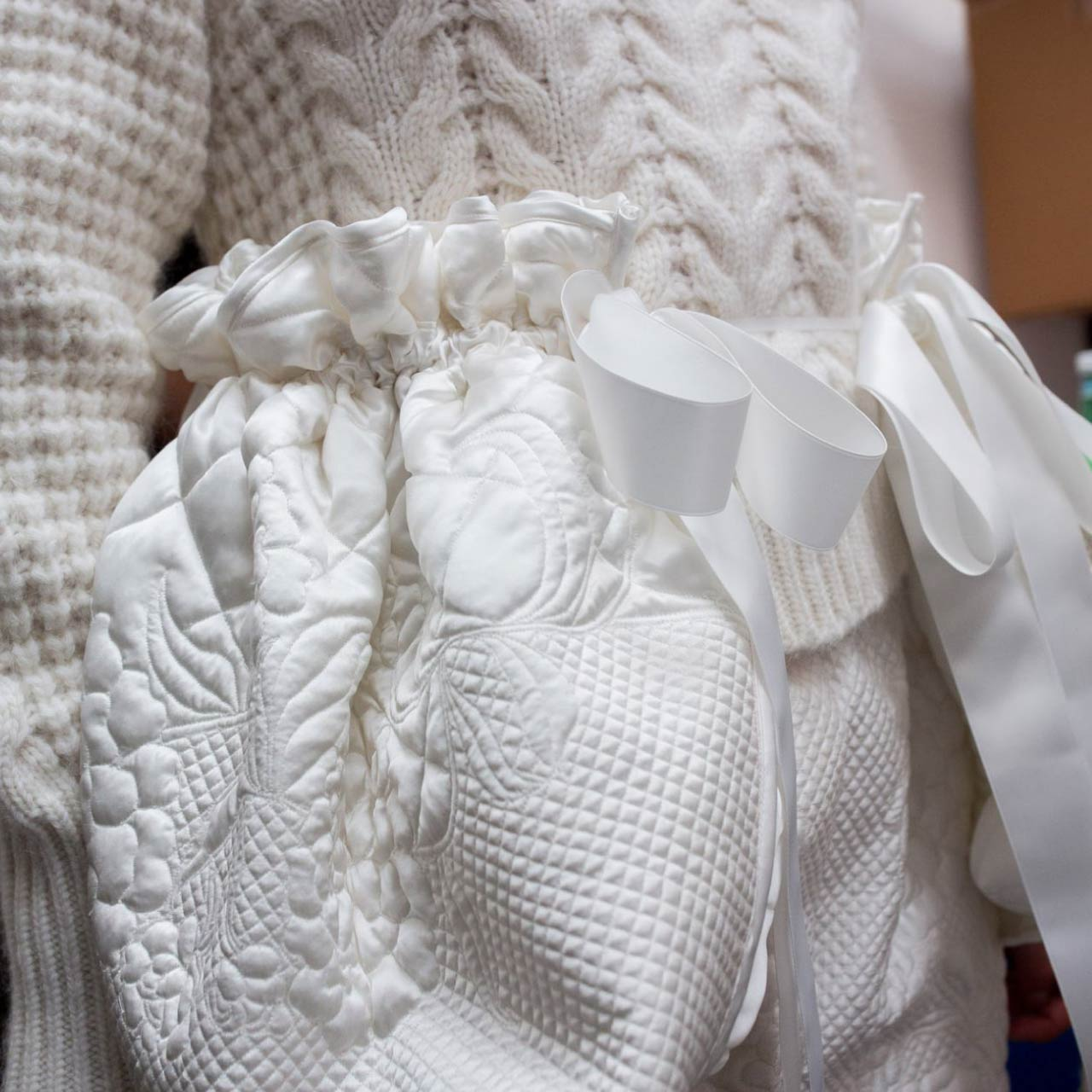 Sumptuous Quilting at Cecilie Bahnsen | The Cutting Class. White quilted satin with knitwear from Autumn-Winter 2018.