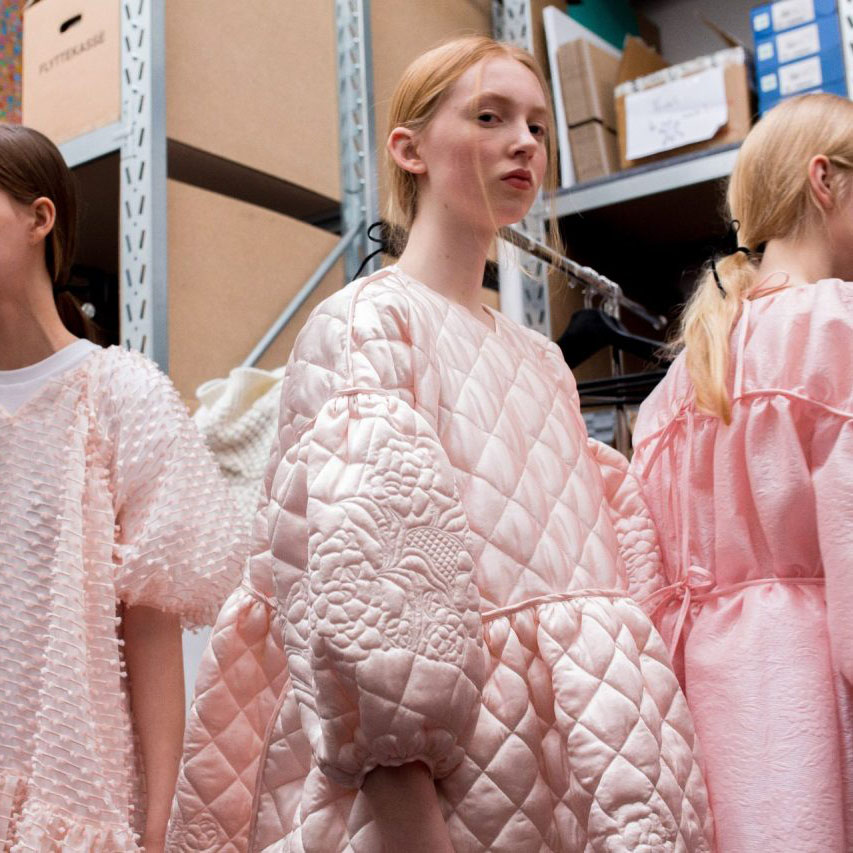 Quilting at Cecilie Bahnsen | The Cutting Class. Models in pink dresses from the Autumn-Winter 2018 collection.