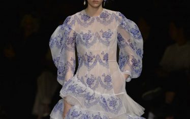 Translucent Layers at Simone Rocha, Spring-Summer 2020. Blue printed design on sheer white background.