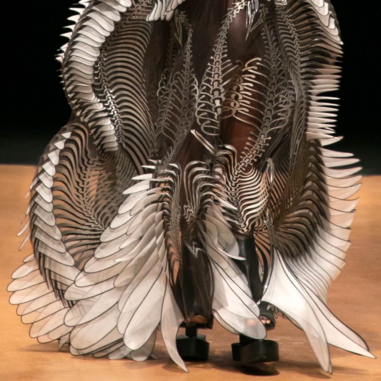 Contemporary Couture Techniques at Iris van Herpen | The Cutting Class. Detail of 'Labrynthine' technique with pearlescent skeletal design.