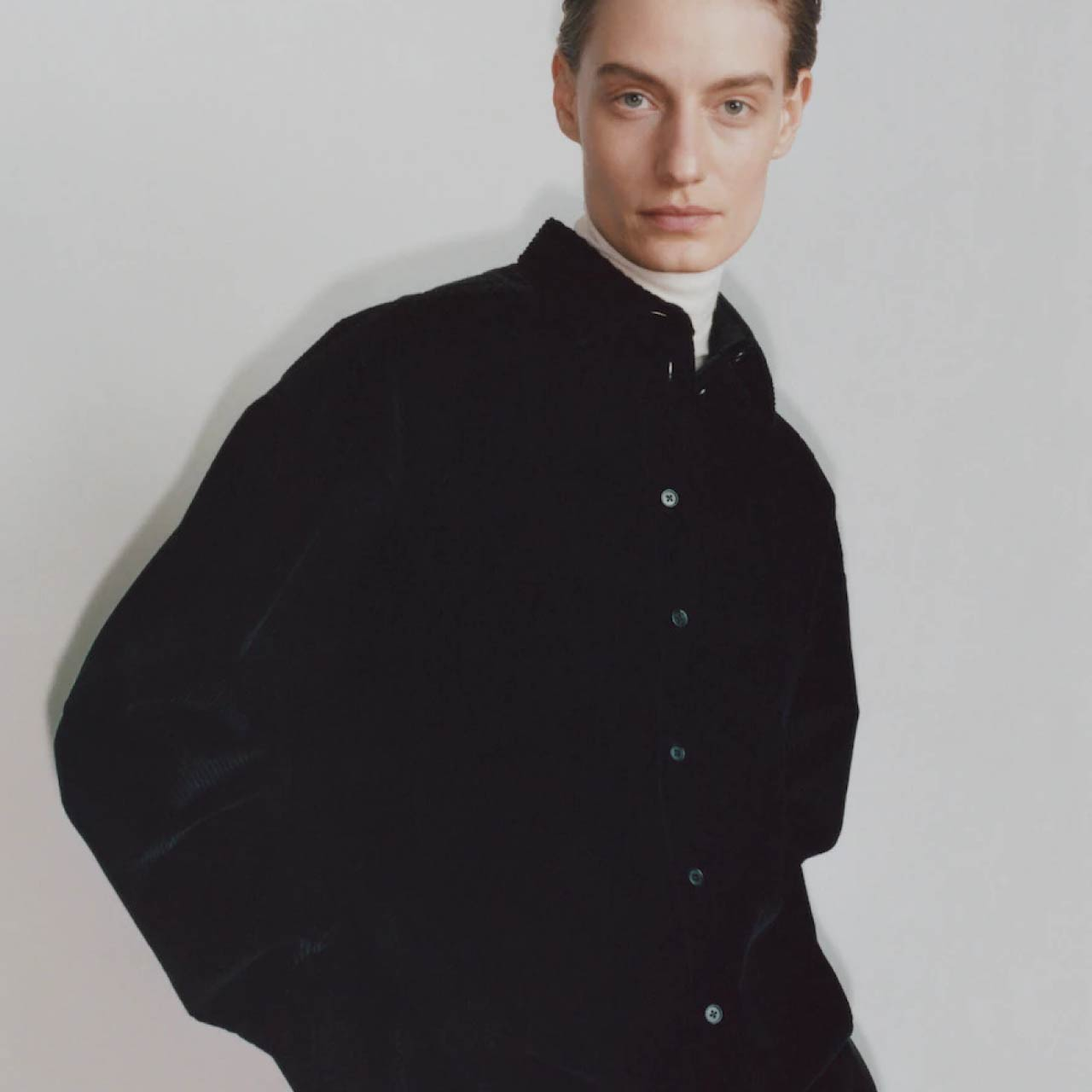 Looks from Pre Fall 2020 at The Row. Black shirt over white turtle neck. The Cutting Class.