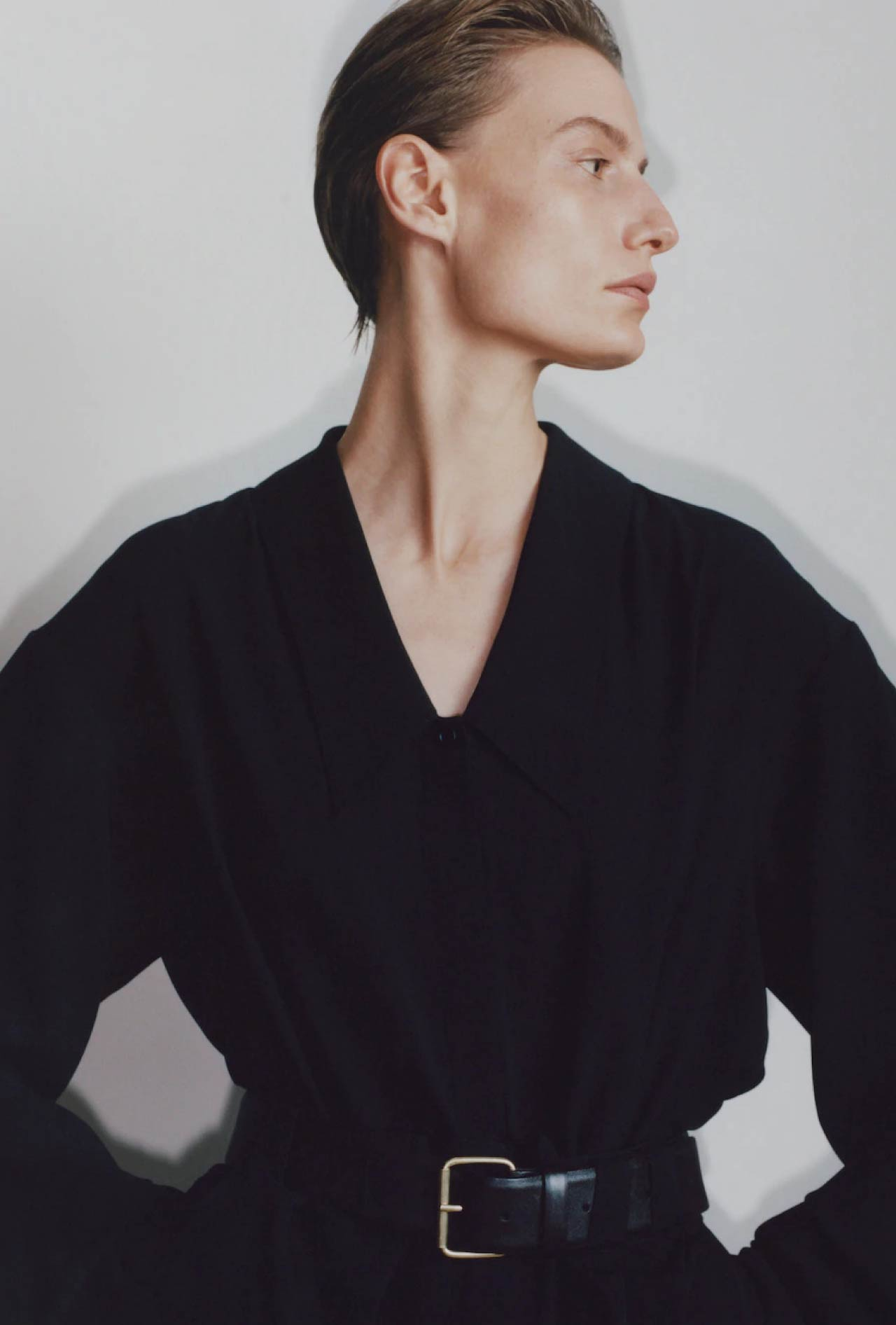 Slight Dropped Shoulders at The Row | The Cutting Class. Low cut neckline / collar on black shirt Pre Fall 2020.